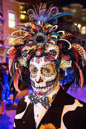 man with sugar skull makeup - large feather headdress - dia de los muertos, bowtie, day of the dead, dia de los muertos, face painting, facepaint, feather headdress, feathers, halloween, hat, man, night, sugar skull makeup