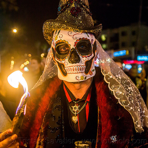 man with sugar skull mask and white lace, burning, day of the dead, dia de los muertos, fire, glittery hat, halloween, lace, man, necklace, night, red, skull mask, veil