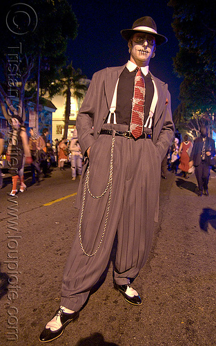 man with suit, hat, watch chain and skull makeup - dia de los muertos - halloween (san francisco), day of the dead, dia de los muertos, face painting, facepaint, halloween, hat, makeup, man, necktie, night, suit, vatra, watch chain