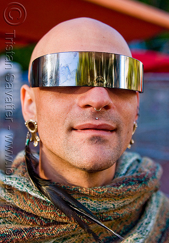 man with visor sunglasses, bald, feather earring, gay pride, gay pride festival, mirror visor, people, shaved head