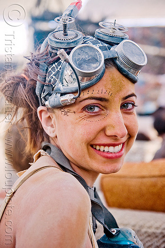 maro with her crazy goggles - burning man 2009, bendy flashlight, burning man, maro, steampunk goggles, woman