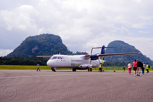 maswings ATR-72 at mulu airport, 9m-mwd, aircraft, atr-72-212a, atr-72-500, boarding, clouds, gunung mulu national park, passengers, people, plane, stol, tarmac, taxiway, turboprop