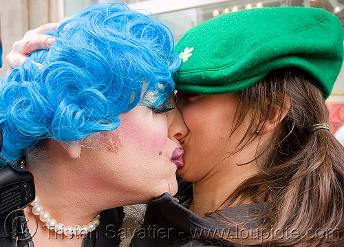 maximum M with blue wig kissing irish girl with green cap - brides of march (san francisco), blue hair, blue wig, brides of march, couple, festival, french kiss, green cap, kissing, making out, man, maximum m, necklace, wedding, white, woman