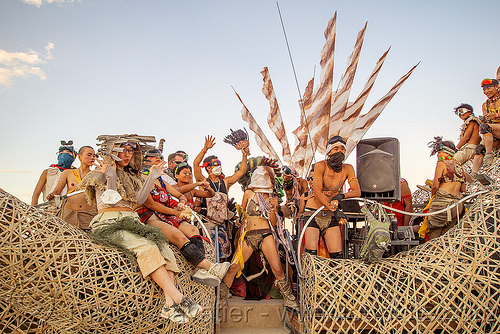 mazu crew on the zulai hand art car - burning man 2016, bamboo, buddha hand art car, burning man, chinese, flags, mazu camp, mutant vehicles, zulai hand art car