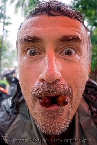me eating big live insect larvas (laos), alive, edible bugs, edible insects, entomophagy, food, laos, larva, larvae, live, luang prabang, man, self portrait, selfie