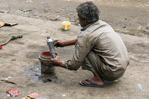 mechanic repairing motorbike shock (india), bucket, fixing, man, mechanic, repairing, shock absorber, sikkim, water, worker