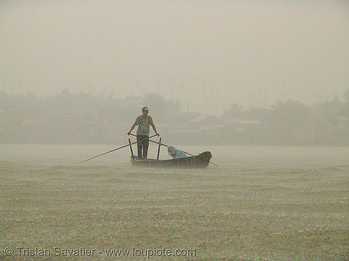 mekong river - monsoon rain - row boat - vietnam, heavy rain, pouring rain, raining, river boat, rowing, rowing boat, small boat, standing, standing rowing