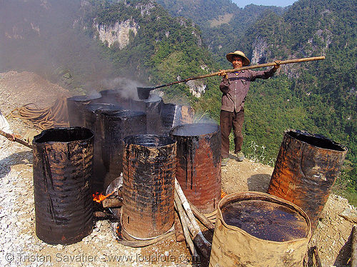 melting barrels of asphalt (bitumen) in barrels with fire - vietnam, barrels, burning, fire, groundwork, hot asphalt, hot bitumen, pavement, paving, road construction, roadworks, smoke, smoking, vietnam