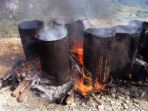 melting barrels of asphalt (bitumen) with wood fire - vietnam, barrels, burning, environment, fire, flames, groundwork, hot asphalt, hot bitumen, macadam, pavement, paving, petroleum, pollution, road construction, roadworks, smoke, smoking