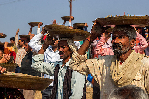 men carrying trays overhead (india), carrying on the head, clay, crowd, hindu ceremony, hindu pilgrimage, hinduism, india, lingams, maha kumbh mela, men, offerings, shiva lingam, trays, walking
