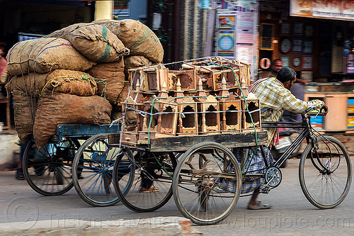 men pushing cargo bikes with heavy loads (india), bags, bearer, cargo tricycle, cargo trike, freight tricycle, freight trike, heavy, load, men, moving, pushing, sacks, street, transport, transportation, transporting, varanasi, walking, wooden