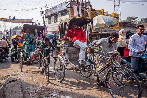 men pushing cycle rickshaws with passengers (india), cycle rickshaws, india, men, passengers, varanasi, walking