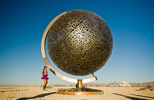 metal globe, art, art installation, ball, burning man, earth, greta, metal sculpture, michael christian, people, playa, sphere, steel, woman