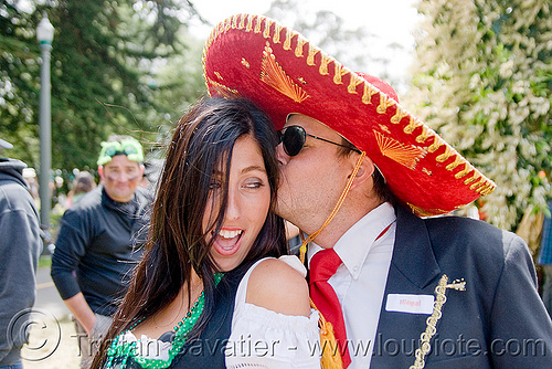 mexican couple with sombrero hat  - bay to breaker footrace and street party (san francisco), bay to breakers, costume, footrace, hat, kissing, man, mexican, red sombrero, street party, woman