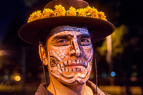 michael paim with sugar skull makeup - dia de los muertos (san francisco), day of the dead, dia de los muertos, face painting, facepaint, flower headdress, halloween, hat, man, marigold flowers, michael paim, night, sugar skull makeup