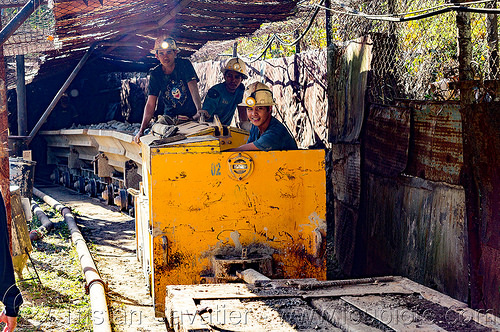 mine trolley with ore - balatoc mines (philippines), balatoc mines, gold mine, head light, mancart, men, mine railway, mine train, mine trolley, mine worker, miner, philippines, safety helmet, workers