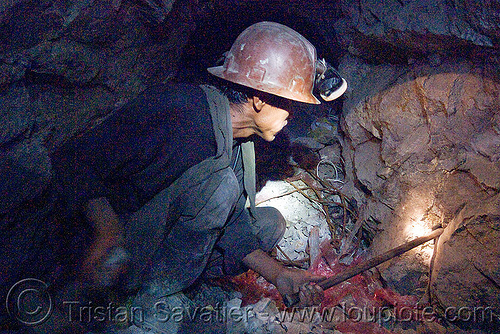 miner hammering chisel to drill blasting hole, cerro rico, chisel, drilling, hammer, man, mina candelaria, mine worker, miner, mining, potosí, safety helmet, squatting, tunnel, working