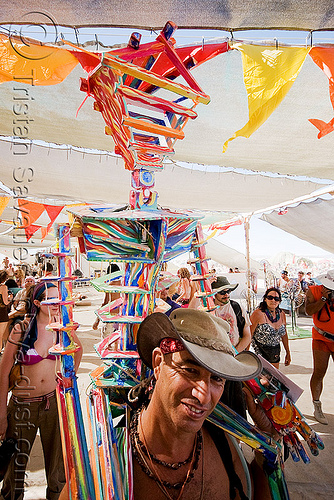 "miniature version of ""the man"" painted with psychadelic colors - burning man 2008, burning man, center camp, hat, painted, the man"
