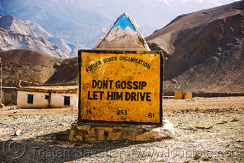 misogyny - don't gossip, let him drive - misogynist road sign in ladakh (india), border roads organisation, bro road signs, gossip, india, ladakh, misogynist, misogyny, mountains, road marker, road sign