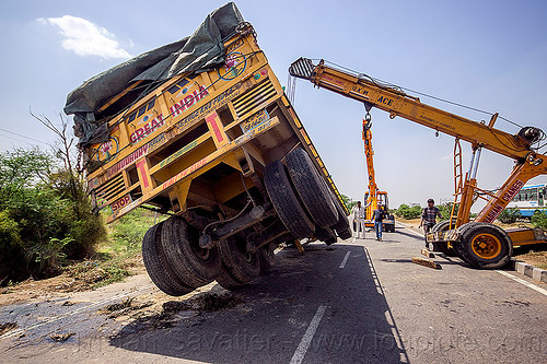 mobile cranes lift overturned semi-trailer truck (india), ace 12xw, artic, articulated truck, at work, crane truck, crash, india, men, mobile crane, overturned, pradhan cranes, road, semi-trailer, tata motors, tractor trailer, traffic accident, truck accident, working, yellow