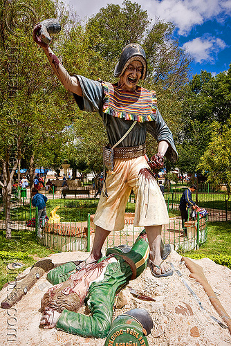 monument to the victory of indigenous quechua warriors over the spaniards - tarabuco (bolivia), blood, bolivia, dead, indigenous, killing, men, montero hat, monument, quechua, sculpture, soldier, statue, tarabuco, victory, warrior