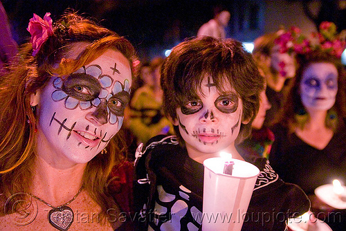 mother and child with skull makeup - dia de los muertos - halloween (san francisco), boy, candle light, child, day of the dead, dia de los muertos, face painting, facepaint, halloween, kid, mother, night, sugar skull makeup, woman