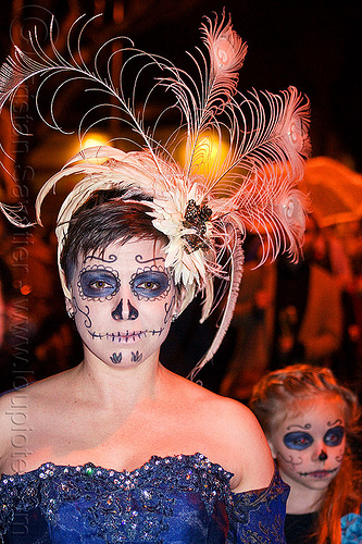 mother and daughter with sugar skull makeup - white feather headdress, blue dress, child, daughter, day of the dead, dia de los muertos, face painting, facepaint, feather headdress, girl, halloween, kid, mother, night, sugar skull makeup, white feathers