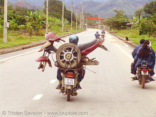 motorbike carrying another motorbike - vietnam, cargo, freight, loaded, motorbikes, motorcycles, rider, riding, road, underbone motorcycle