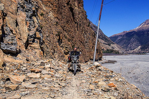 motorbike on rocky road - annapurnas (nepal), 350cc, annapurnas, cliff, dirt road, kali gandaki valley, motorbike touring, motorcycle touring, mountain road, rider, riding, rocks, royal enfield bullet, stones, thunderbird, tristan savatier, unpaved