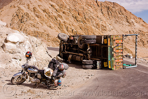 motorcycle and overturned truck - khardungla pass - ladakh (india), bullet, crash, india, khardung la pass, ladakh, lorry, motorcycle touring, mountain pass, mountains, overturned truck, road, royal enfield, tata motors, traffic accident, truck accident, underbelly, wreck