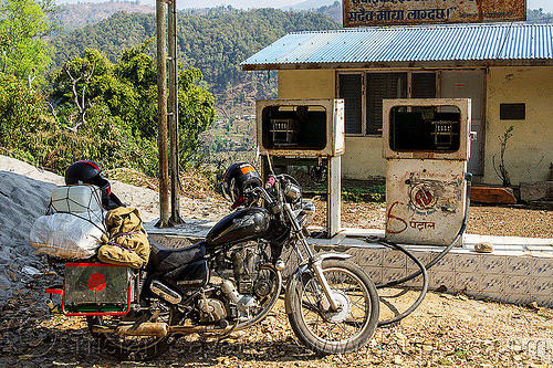 motorcycle at abandoned gas station (nepal), 350cc, abandoned, bags, gas pump, gas station, luggage, motorbike touring, motorcycle touring, petrol pump, petrol station, royal enfield bullet, thunderbird