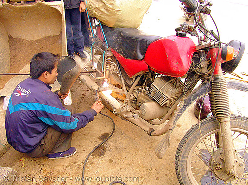 motorcycle repair - blacksmith doing arc welding - vietnam, 125cc, arc soldering, arc welding, blacksmith, fixing, man, minsk motorcycle, motorcycle repair, motorcycle touring, mèo vạc, repairing, road, vietnam, welder, worker, working, минск 125, мотоциклы