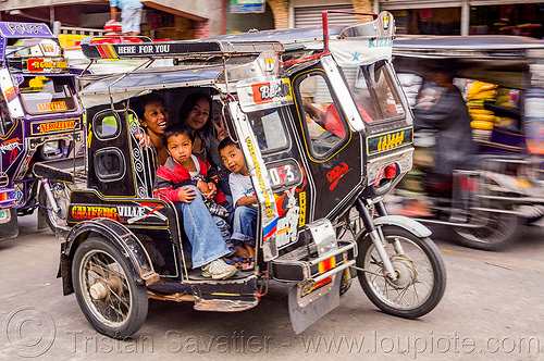 motorized tricycles - bontoc (philippines), bontoc, children, family, kids, motorbikes, motorcycles, motorized tricycles, passengers, philippines, public transportation, sidecar, street, woman