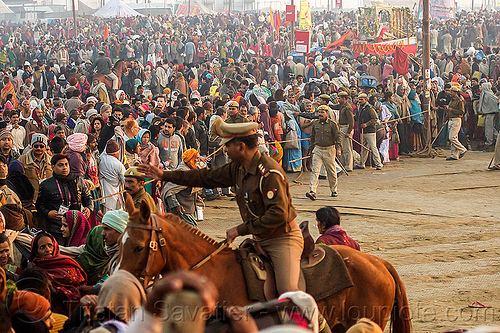 mounted police clearing access to sangam bathing area - kumbh mela (india), cops, crowd control, dawn, hindu pilgrimage, hinduism, horse riding, horseback riding, india, kumbh maha snan, maha kumbh mela, mauni amavasya, mounted police, police horses, police officers, triveni sangam