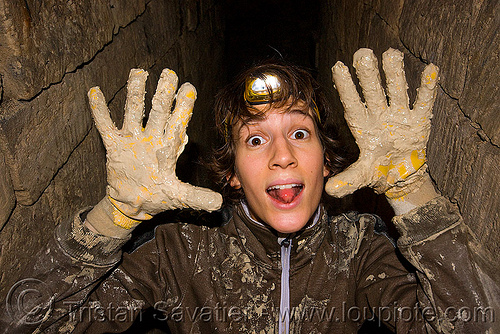 muddy hands - catacombes de paris - catacombs of paris (off-limit area) - juju - julie, cave, clandestines, gloves, hands, headlamp, headlight, illegal, led light, mud, muddy, paris, petzl, tikka, trespassing, underground quarry, woman