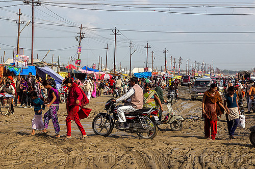 muddy market street (india), botorcycle, cars, hindu, hinduism, kumbha mela, maha kumbh mela, motorbike, mud ruts, muddy road, muddy street, traffic, underbone motorcycle, walking