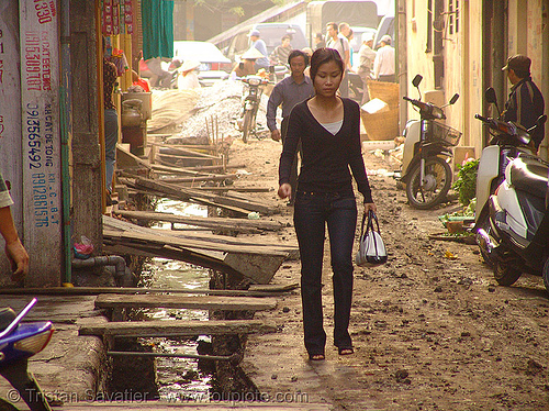 muddy street - open sewage (hanoi) - vietnam, asian woman, groundwork, hanoi, mud, muddy, road construction, roadworks, vietnam