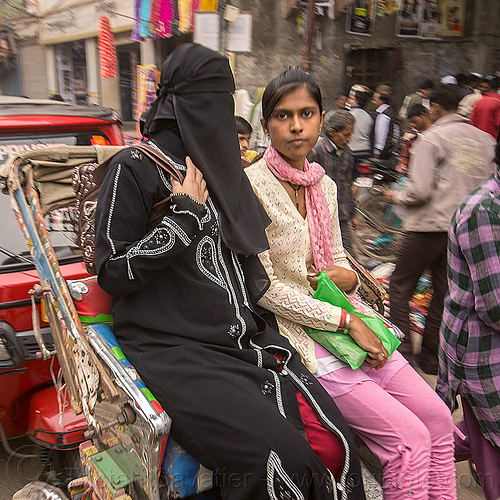 muslim woman in niqab, riding rickshaw with hindu woman, cycle rickshaw, hindu, islam, muslim, niqab, religion, street, varanasi, women