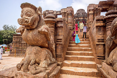 mustachioed stone tiger over elephant - konark sun temple (india), hindu temple, hinduism, konark sun temple, sculptures, stairs, statue, steps, stone elephant, tourists
