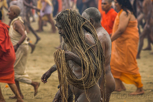 naga baba with long dreadlocks - kumbh mela (india), crowd, dreadlocks, hindu pilgrimage, hinduism, india, maha kumbh mela, men, naga babas, naga sadhus, sadhu, vasant panchami snan, walking
