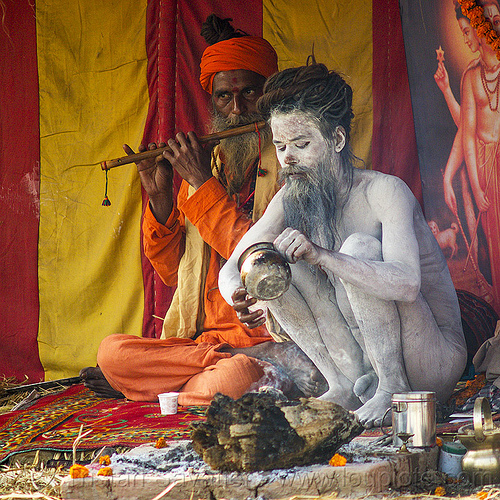 naga sadhu with vibhuti holy ash (india), babas, beard, bhagwa, bodypaint, bodypainted, dreadlocks, dreads, hindu, hinduism, holy ash, kumbha mela, maha kumbh mela, men, naga baba, naga sadhu, naga sâdhu, naked, orange color, paush purnima, pilgrims, playing the flute, sacred ash, sadhus, saffron color, sitting, vibhuti, white ash, yahtri, yatris