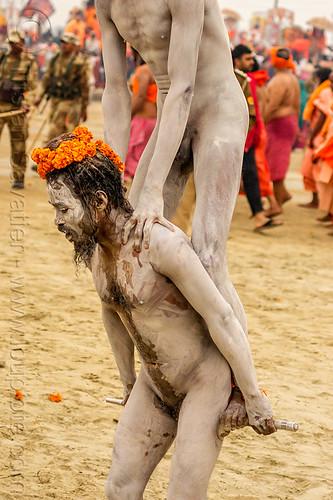 naga sadhus performing stick trick - kumbh mela 2013 festival (india), hindu, hinduism, holy ash, kumbha mela, maha kumbh mela, man, naga baba, naga sadhu, naked, sacred ash, stick, two, vibhuti, wrapped
