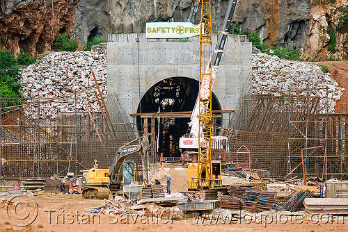 nam theun 2 hydroelectric project (laos) - adit - downstream canal tunnel exit, construction, crane, excavator, heavy equipment, hydraulic, hydro-electric, infrastructure, machinery, mem, nam theun power company, ntpc, safety first, tunneling equipment, tunneling machine