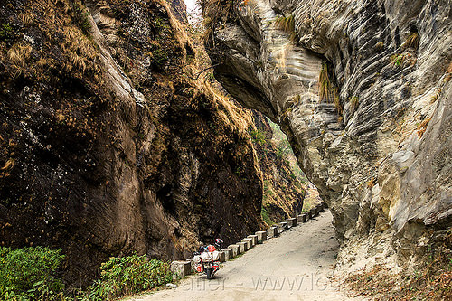 narrow gorge - overhanging rock  - road between beni and jomsom (nepal), annapurnas, canyon, cliff, dirt road, gorge, kali gandaki valley, motorcycle touring, mountain road, mountains, overhanging rock, unpaved