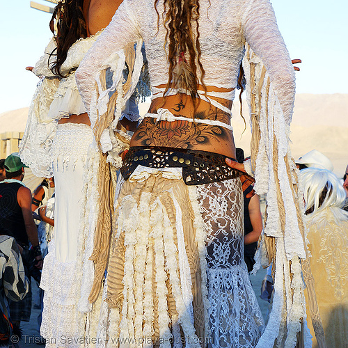 natalia and pema at the silent white procession - burning man 2007, burning man, dawn, feathers, lotus flower tattoo, natalia, pema, stilts, stiltwalker, stiltwalking, tattooed, tattoos, white morning