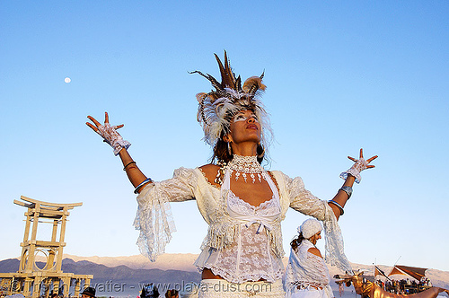 natalia at the silent white procession - burning man 2007, burning man, dawn, feathers, natalia, silent white procession, stilts, stiltwalker, stiltwalking, sun rise, temple, white morning, woman