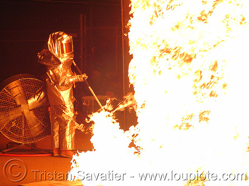 nate smith in his fire proximity suit, burning, fire art, fire proximity suit, fire resistant, firenado, flame resistant clothing, flame-resistant suit, fr, man, nate smith, pillar of fire, silver bunker suit