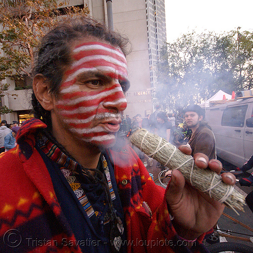 native american burning sage at halloween critical mass (san francisco) - zachary running wolf, american flag, american indian, amerindian, face painting, facepaint, first nations, flag makeup, halloween critical mass, man, native american, sage, salvia, smoke, smoking, us flag, zachary running wolf