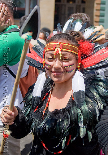 native american feather costume, american indian costume, bay to breakers, black feathers, face painting, facepaint, feather headdress, feather necklace, footrace, makeup, native american costume, spear, street party, warrior, woman