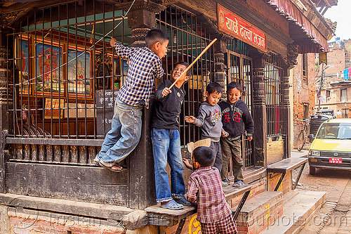 nepali boys playing around a pati (nepal), bhaktapur, children, grid, kids, people, street